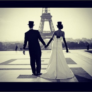French bride and groom in front of the eiffel tower